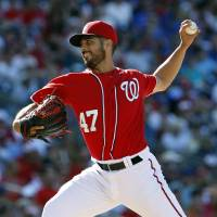 Photo - Washington Nationals starting pitcher Gio Gonzalez throws during the fourth inning of a baseball game against the Chicago Cubs at Nationals Park, Saturday, July 5, 2014, in Washington. (AP Photo/Alex Brandon)