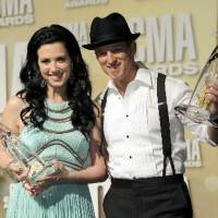 Photo -  Shawna and Keifer Thompson show off their trophies backstage at the CMA Awards.