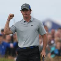 Photo - Rory McIlroy of Northern Ireland celebrates after playing an eagle on the 16th hole during the third day of the British Open Golf championship at the Royal Liverpool golf club, Hoylake, England, Saturday July 19, 2014. (AP Photo/Jon Super)