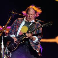 Photo - Neil Young performs with his band Crazy Horse at the Global Citizen Festival in Central Park on Sept. 29 in New York. AP PHOTO  Evan Agostini