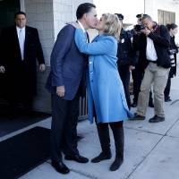 Photo -   Republican presidential candidate, former Massachusetts Gov. Mitt Romney kisses wife Ann Romney after they voted in Belmont, Mass., Tuesday, Nov. 6, 2012.(AP Photo/Charles Dharapak)