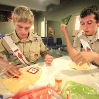 Photo - Jonah Moore and Matt Harger work to replace Boy Scout regalia lost in a recent wildfire.Photo by David McDaniel, The Oklahoman
