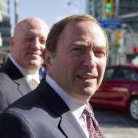 Photo -   NHL commissioner Gary Bettman, foreground, arrives with deputy commissioner Bill Daly as the NHL and its locked-out player resume negotiations in Toronto on Wednesday Oct. 16, 2012. (AP Photo/The Canadian Press, Chris Young)