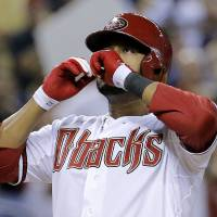 Photo - Arizona Diamondbacks' Andy Marte celebrates his two run home run against the Pittsburgh Pirates during the sixth inning of a baseball game, Thursday, July 31, 2014, in Phoenix. (AP Photo/Matt York)