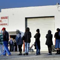 Photo - Jesus House distributed turkeys and grocery items Tuesday morning,  Nov. 19, 2012. Officials said they had 400 turkeys and food baskets to distribute and people were standing in line when their doors opened at 8 a.m. In less than two hours, all turkeys had been claimed. They will pass out 400 more turkeys and food baskets on Wednesday.  Photo by Jim Beckel, The Oklahoman
