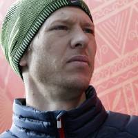 Photo - Todd Lodwick of the United States listens to questions from journalists during a men's nordic combined training session in the ski jumping stadium at the 2014 Winter Olympics, Monday, Feb. 10, 2014, in Krasnaya Polyana, Russia. (AP Photo/Matthias Schrader)