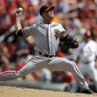 Photo - San Francisco Giants starting pitcher Tim Hudson throws during the fifth inning of a baseball game against the St. Louis Cardinals, Sunday, June 1, 2014, in St. Louis. (AP Photo/Jeff Roberson)