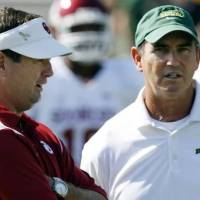 Photo -  Baylor coach Art Briles chats with OU coach Bob Stoops before a game. (Photo by Steve Sisney)