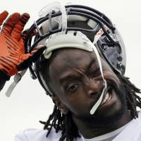 Photo - Chicago Bears cornerback Charles Tillman removes his helmet during NFL football training camp Saturday, July 27, 2013, at Olivet Nazarene University in Bourbonnais, Ill. (AP Photo/Nam Y. Huh)