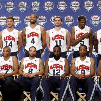 Photo - Coach Mike Krzyzewski, left, and USA Basketball chairman Jerry Colangelo, right, stand with the 12 players named to the U.S. men's basketball team, Saturday, July 7, 2012, in Las Vegas. From left in front are Chris Paul, Russell Westbrook, Deron Williams, James Harden, Andre Iguodala and Kobe Bryant. At rear are Carmelo Anthony, Blake Griffin, Tyson Chandler, Kevin Love, Kevin Durant and LeBron James. (AP Photo/Las Vegas Review-Journal, Jason Bean) LOCAL TV OUT  LOCAL INTERNET OUT   LAS VEGAS SUN OUT ORG XMIT: NVLAS108