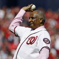 Photo -   Former Washington Nationals manager Frank Robinson throws out the ceremonial first pitch before Game 3 of the National League division baseball series between the Nationals and the St. Louis Cardinals on Wednesday, Oct. 10, 2012, in Washington. (AP Photo/Alex Brandon)