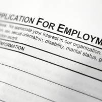 Photo - This April 22, 2014 photo shows an employment application form sits on a table during a job fair at Columbia-Greene Community College in Hudson, N.Y. The Labor Department releases employment data for April on Friday, May 2, 2014. (AP Photo/Mike Groll)