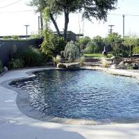 Photo - Susie and Robert Reid 1143 NW 57TH Street  On Tour:  Back yard pool/garden and pond   - PROVIDED
