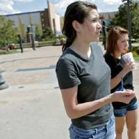 Photo - Kelsea Hammons, (center) and her friend Brittney Campbell (right) talk about the night they were arrested outside Harkins Bricktown Theater in Oklahoma City on Tuesday, July 19, 2011. Photo by John Clanton, The Oklahoman ORG XMIT: KOD