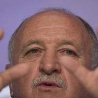 Photo - Brazil's soccer coach Luiz Felipe Scolari speaks during a news conference after announcing his list of players for the 2014 Soccer World Cup in Rio de Janeiro, Brazil, Wednesday, May 7, 2014. The team will mix talented young stars such as Neymar and Oscar with more experienced players such as Dani Alves, David Luiz, Thiago Silva and Hulk. (AP Photo/Felipe Dana)