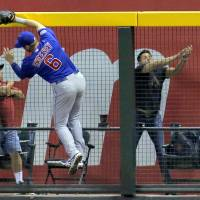 Photo - Chicago Cubs' Ryan Sweeney (6) can't catch a solo home run hit by Arizona Diamondbacks' Paul Goldschmidt during the sixth inning of a baseball game, Friday, July 18, 2014, in Phoenix. (AP Photo/Matt York)