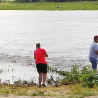 Photo -  Anglers try their luck Friday morning on the west side of Lake Hefner where the canal enters in Oklahoma City. The area has been a hot spot for catfish this month. Photo by Paul B. Southerland, The Oklahoman   PAUL B. SOUTHERLAND -  PAUL B. SOUTHERLAND