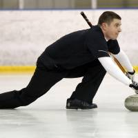 Photo - Ryan McGhee delivers a stone while curling with the Oklahoma Curling Club at the Arctic Edge Ice Arena in Edmond, Okla., Sunday, Jan. 26, 2014. Photo by Nate Billings, The Oklahoman