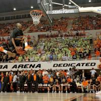 Photo - OSU's Markel Brown goes for a dunk in a dunk contest during Homecoming and Hoops at Oklahoma State University on Friday, October 22, 2010.  Photo by Bryan Terry, The Oklahoman