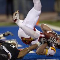 Photo -   Iowa State wide receiver Josh Lenz (19) scores a touchdown over the top of Kansas cornerback Greg Brown (5) during the second half of an NCAA college football game in Lawrence, Kan., Saturday, Nov. 17, 2012. (AP Photo/Orlin Wagner)