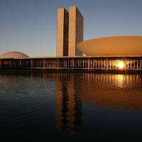 Photo - FILE - This Aug 14, 2007 file photo, shows a view of the Brazil's National Congress, designed by Brazilian architect Oscar Niemeyer and inaugurated in 1960, in Brasilia, Brazil. According to a hospital spokeswoman on Wednesday, Dec. 5, 2012, famed Brazilian architect Oscar Niemeyer has died at age 104.  (AP Photo/Eraldo Peres, File)