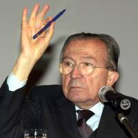 Photo - FILE - In this Dec. 8, 2001 file photo Italian life senator Giulio Andreotti gestures during a press conference.  Italian state television says Giulio Andreotti, Italy's former seven-time premier, has died at age 94. At his prime, Andreotti was one of Italy's most powerful men: he helped draft the country's constitution after World War II, sat in parliament for 60 years and served as premier seven times. Andreotti was hospitalized last year with heart problems stemming from a respiratory infection. (AP Photo/Luca Bruno/Files)