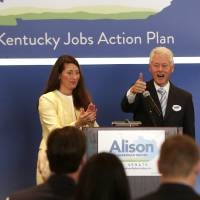 Photo - Former President Bill Clinton campaigns for Alison Lundergan Grimes, left, during an event at the Carrick House in Lexington, Ky., Wednesday, Aug. 6, 2014. Grimes is the Democratic challenger to Sen. Mitch McConnell.  (AP Photo/The Herald-Leader, Pablo Alcala)