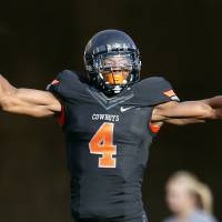 Photo - Oklahoma State's Justin Gilbert (4) celebrates a TCU missed field goal during a college football game between Oklahoma State University (OSU) and Texas Christian University (TCU) at Boone Pickens Stadium in Stillwater, Okla., Saturday, Oct. 27, 2012. Photo by Sarah Phipps, The Oklahoman