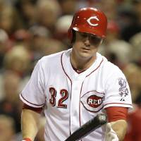 Photo - Cincinnati Reds' Jay Bruce tosses his bat after striking out against Milwaukee Brewers starting pitcher Wily Peralta in the sixth inning of a baseball game on Friday, May 2, 2014, in Cincinnati. (AP Photo/Al Behrman)