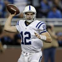 Photo - Indianapolis Colts quarterback Andrew Luck throws against the Detroit Lions in the first quarter of an NFL football game in Detroit, Sunday, Nov. 2, 2012. (AP Photo/Paul Sancya)