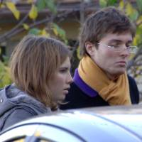 Photo - FILE - This Nov. 2, 2007 file photo shows Amanda Marie Knox, of the U.S., left, and her then-boyfriend Raffaele Sollecito, of Italy, outside the rented house where 21-year-old British student Meredith Kercher was found dead in Perugia, Italy. The Court of Cassation on Monday March 25, 2013 is considering prosecutors' contentions that the 2011 acquittals of American Knox and her Italian ex-boyfriend in the murder of British student Meredith Kercher should be thrown out and a new trial ordered. (AP Photo/Stefano Medici, File)