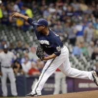 Photo - Milwaukee Brewers starting pitcher Wily Peralta throws during the first inning of a baseball game against the Colorado Rockies on Thursday, June 26, 2014, in Milwaukee. (AP Photo/Morry Gash)