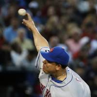 Photo - New York Mets starting pitcher Bartolo Colon throws in the first inning of baseball game against the Atlanta Braves, Tuesday, April 8, 2014, in Atlanta. (AP Photo/David Goldman)