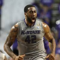 Photo - Kansas State's Thomas Gipson reacts after sinking a basket during the first half of an NCAA college basketball game against Iowa State  Saturday, March 1, 2014, in Manhattan, Kan. (AP Photo/Charlie Riedel)