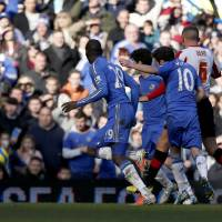 Photo - Chelsea's Juan Mata, second right, scores during the English FA Cup fourth round replay soccer match between Chelsea and Brentford at Stamford Bridge stadium in London, Sunday, Feb. 17, 2013.  (AP Photo/Matt Dunham)