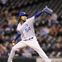 Photo - Kansas City Royals starting pitcher Ervin Santana throws to a Seattle Mariners batter in the first inning of a baseball game Wednesday, Sept. 25, 2013, in Seattle. (AP Photo/Elaine Thompson)