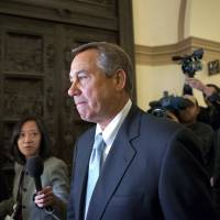 Photo - House Speaker John Boehner of Ohio arrives on Capitol Hill in Washington, Friday, March 1, 2013, after a meeting at the White House between President Barack Obama and Congressional leaders before billions of dollars in mandatory budget cuts were to start. The meeting — lasting less than an hour — yielded no immediate results. (AP Photo/J. Scott Applewhite)