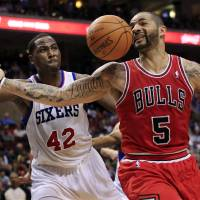 Photo -   Chicago Bulls' Carlos Boozer (5) loses the ball as he is defended by Philadelphia 76ers' Elton Brand (42) during the first quarter of Game 3 in an NBA basketball first-round playoff series in Philadelphia, Friday, May 4, 2012. (AP Photo/Mel Evans)