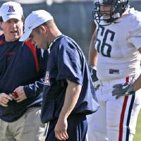 Photo - Coach Bill Bedenbaugh, left, during a practice at Arizona in 2007. Photo by A. E. Araiza/Arizona Daily Star via AP
