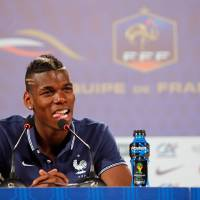 Photo - France's Paul Pogba answers journalists' questions during a press conference at the Teatro Pedro II, in Ribeirao Preto, Brazil, Tuesday, June 10, 2014. France will face Ecuador, Switzerland and Honduras in group E of the World Cup. (AP Photo/David Vincent)