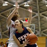 Photo - Penn guard Meghan McCullough, right, drives against Princeton guard Blake Dietrick during the first half of an NCAA college basketball game, Tuesday, March 11, 2014, in Princeton, N.J. (AP Photo/Julio Cortez)
