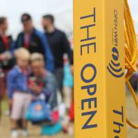 Photo - A sign advertising WiFi near the 3rd hole on the course at the Royal Liverpool golf club where the British Open Golf championship will start Thursday July 17, in Hoylake, England, Wednesday July 16, 2014. (AP Photo/Jon Super)