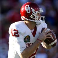 Photo - Oklahoma's Landry Jones looks to pass the ball during the second half of the Brut Sun Bowl college football game between the University of Oklahoma Sooners (OU) and the Stanford University Cardinal on Thursday, Dec. 31, 2009, in El Paso, Tex.   Photo by Chris Landsberger, The Oklahoman ORG XMIT: KOD