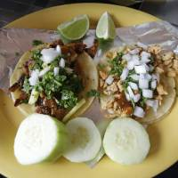 Photo - In this July 29, 2014, photo, a plate of Taco Al Pastor is displayed at Chunga's Mexican Grill, in Salt Lake City. The hunt for a taste of Mexico City brings diners near a highway overpass in a neighborhood known for tire shops and tacos. (AP Photo/Rick Bowmer)