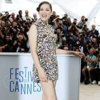 Photo - Actress Marion Cotillard poses for a photographers during a photo call for Two Days, One Night (Deux jours, une nuit) at the 67th international film festival, Cannes, southern France, Tuesday, May 20, 2014. (AP Photo/Alastair Grant)