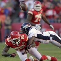 Photo - Denver Broncos cornerback Champ Bailey (24) breaks up a pass intended for Kansas City Chiefs wide receiver Dwayne Bowe (82) during the second half of an NFL football game on Sunday, Nov. 25, 2012, in Kansas City, Mo. The Broncos won the game 17-9. (AP Photo/Charlie Riedel)
