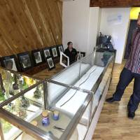Photo - James Lathrop, right, the owner of the recreational marijuana store Cannabis City, checks out display case with glass bongs on display and an empty area awaiting actual marijuana, Monday, July 7, 2014, in Seattle. The store will be the first and only store in Seattle to initially sell recreational marijuana when legal sales begin on Tuesday, July 8, 2014. (AP Photo/Ted S. Warren)