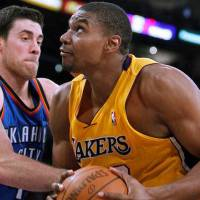 Photo - Oklahoma City Thunder forward Nick Collison, left, stops Los Angeles Lakers center Andrew Bynum from shooting a shot during the second half of an NBA basketball game, Monday, Jan. 17, 2011, in Los Angeles. Lakers won the game 101-94.  (AP Photo/Alex Gallardo)