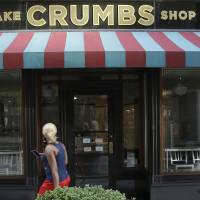Photo -  A Crumbs cupcake shop sits empty Tuesday on Federal Street  in Boston. AP Photo   Stephan Savoia