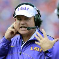 Photo -   LSU head coach Les Miles yells to his bench after a penalty during the first half of an NCAA college football game against Florida, Saturday, Oct. 6, 2012, in Gainesville, Fla. (AP Photo/John Raoux)